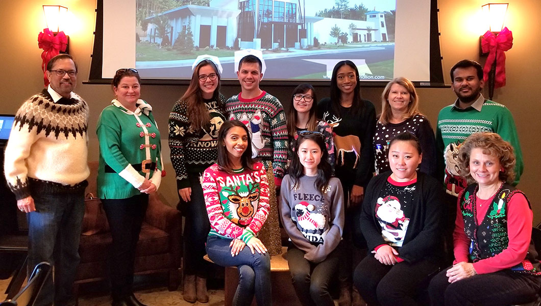 Aventure Aviation – The finalists of Aventure′s ugly sweater contest at the company's holiday luncheon