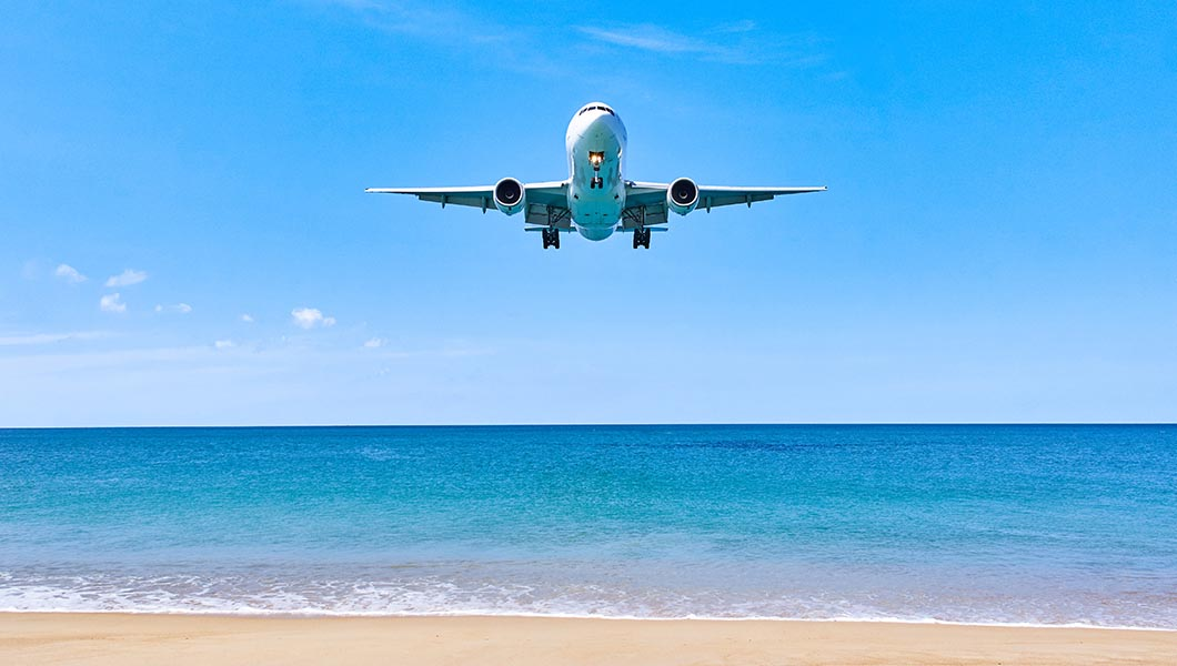 Aventure Aviation | Commercial aircraft flying over Mexican beach