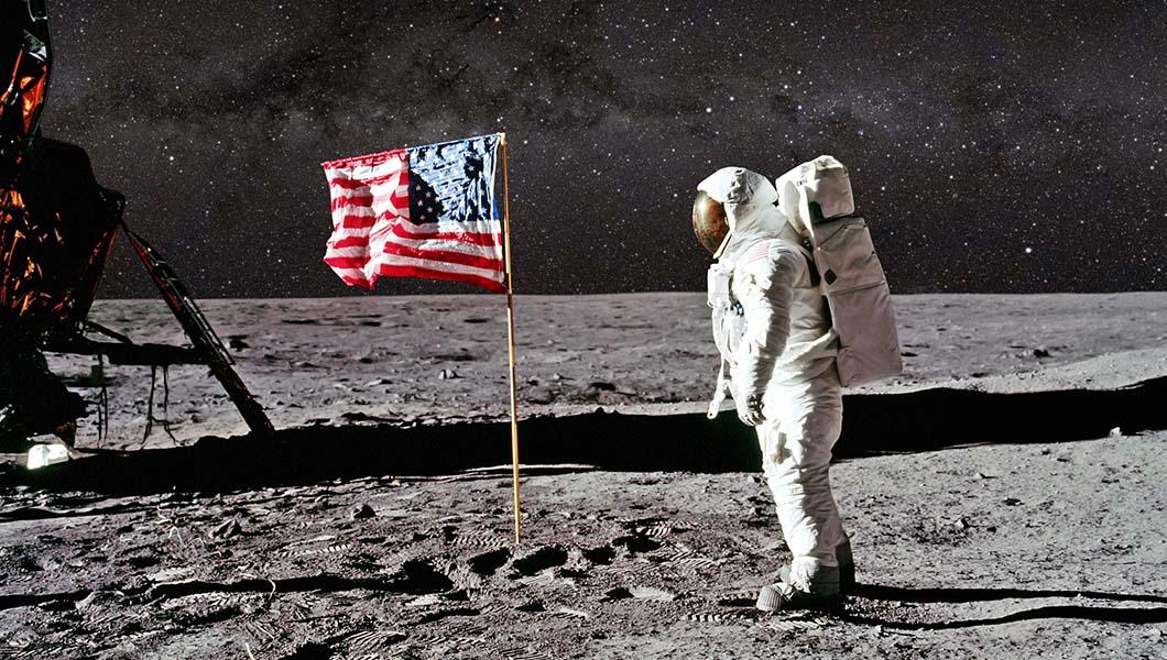 Aventure Aviation   Astronaut saluting U.S. flag on the moon