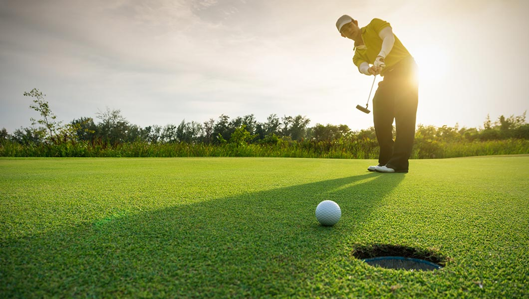 Golfer on green