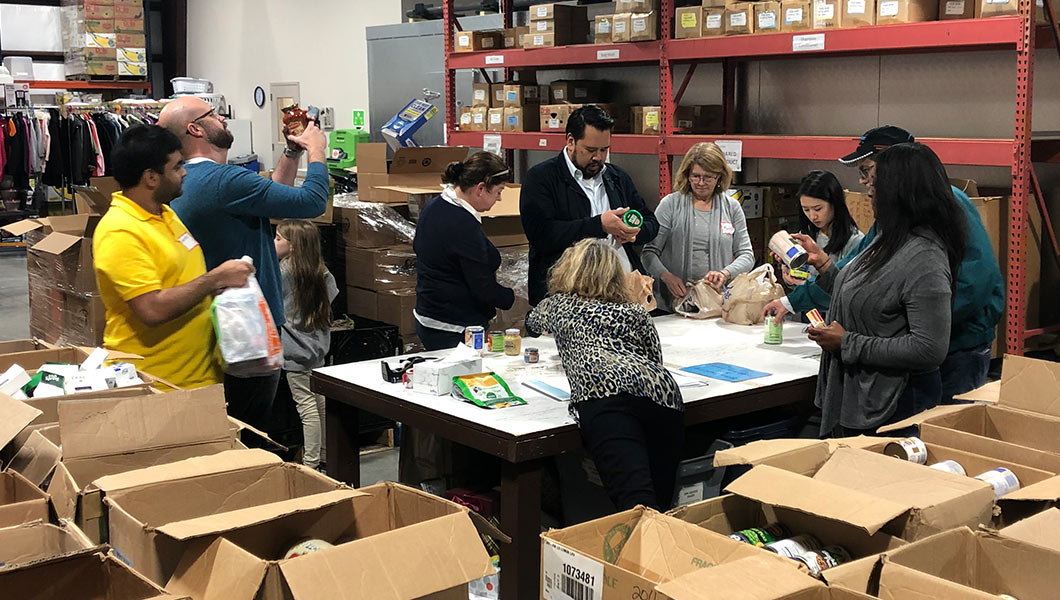 Aventure Aviation staff sorting food at the Real Life Center warehouse