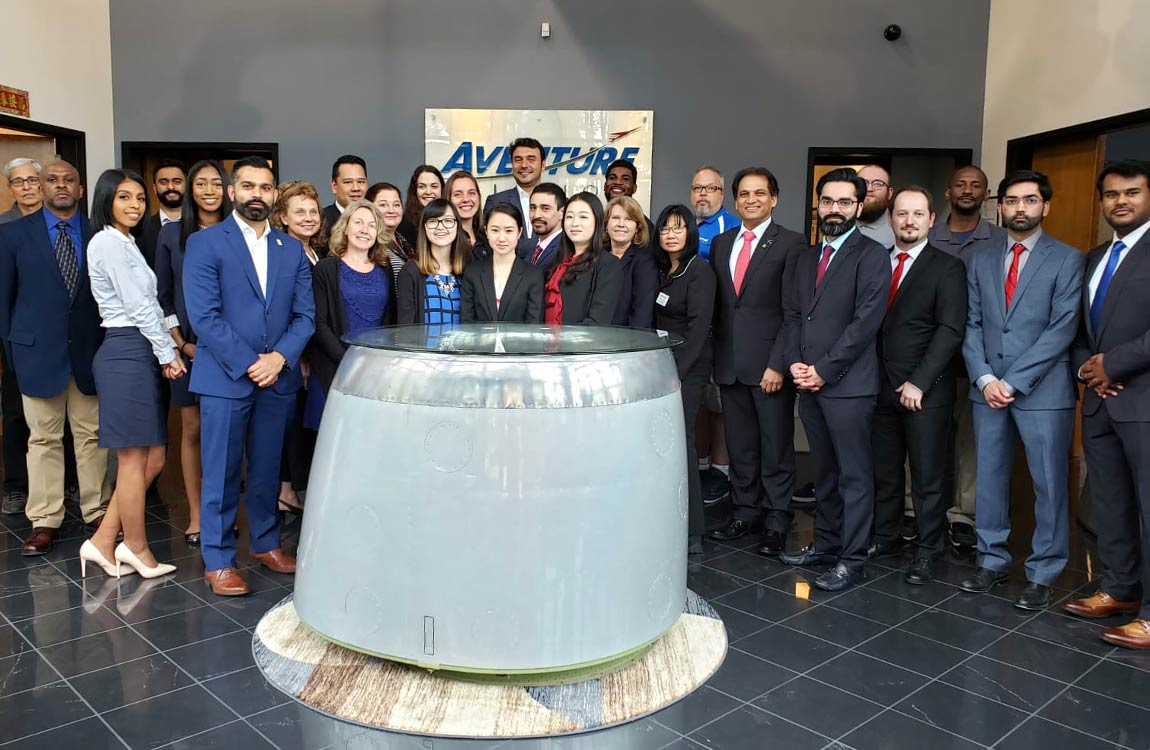 Team Aventure inside the lobby of Aventure Aviation's main facility in Peachtree City, Georgia, USA.