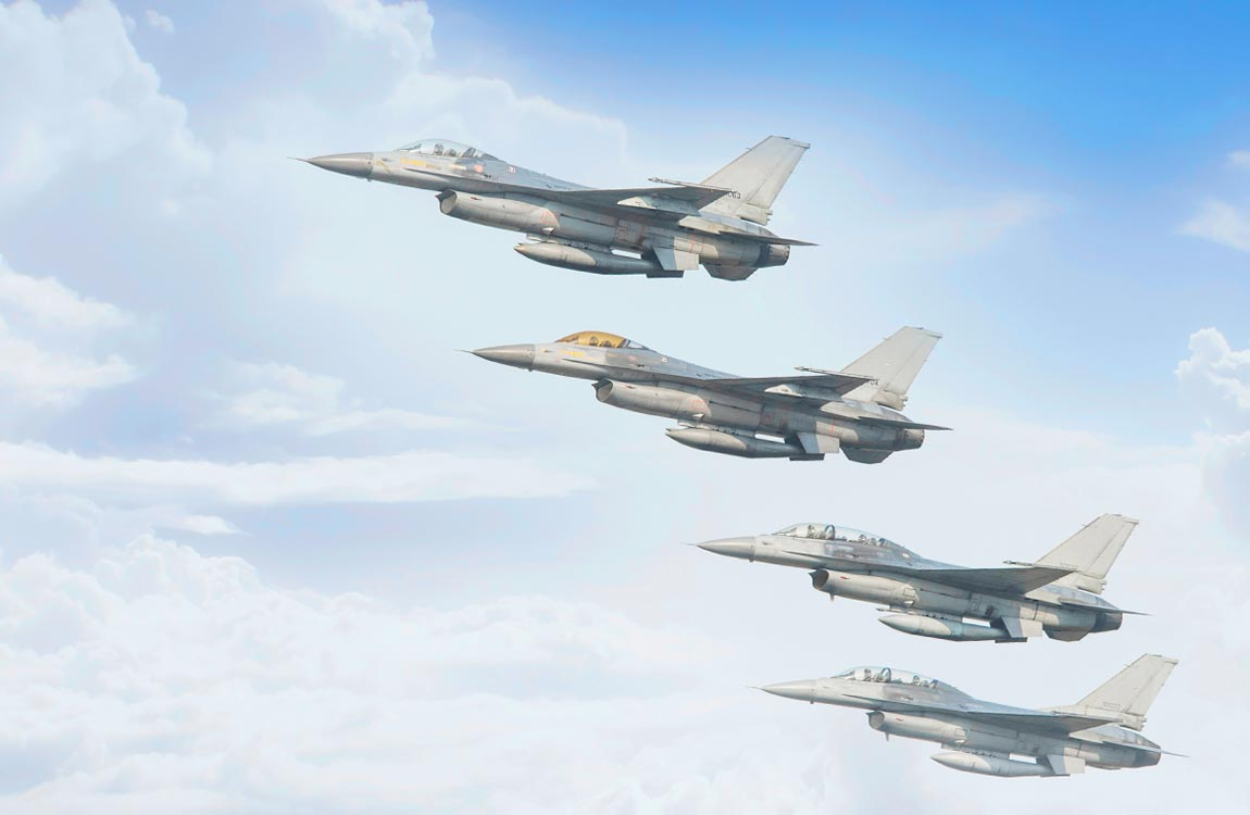 Four F-16 fighter jets in close formation flight